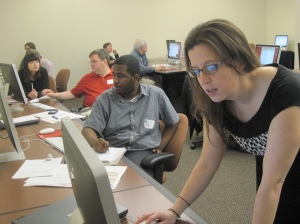 Nelson at a CAR workshop in 2012 taught by Jaimi Dowdell (foreground), training director for Investigative Reporters and Editors.  Photo courtesy of Donald W. Reynolds National Center for Business Journalism, via Flickr.